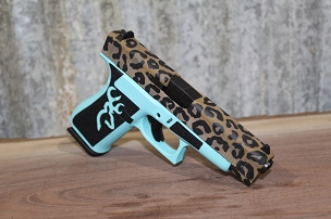 Glock 48 with Leopard Cerakote and Buck Emblem Laser Stippling